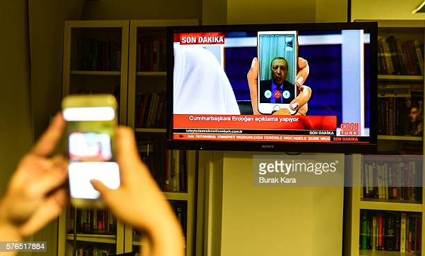 Turkish President Recep Tayyip Erdogan speaks on CnnTurk via facetime call in the early morning hours of July 16 2016 in Istanbul Turkey Istanbul's...