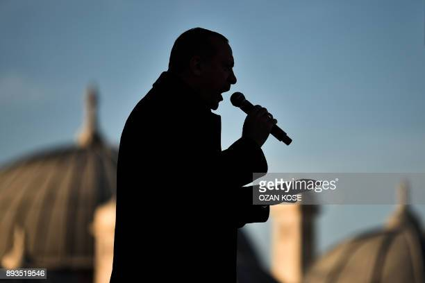TOPSHOT Turkish President Recep Tayyip Erdogan speaks on December 15 2017 in Istanbul during the inauguration ceremony of Turkey's first automated...