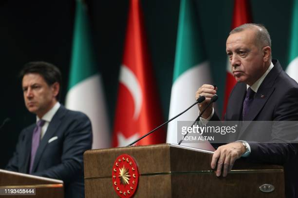 Turkish President Recep Tayyip Erdogan speaks past Italian Prime Minister Italy Giuseppe Conte as they give a press conference following their...