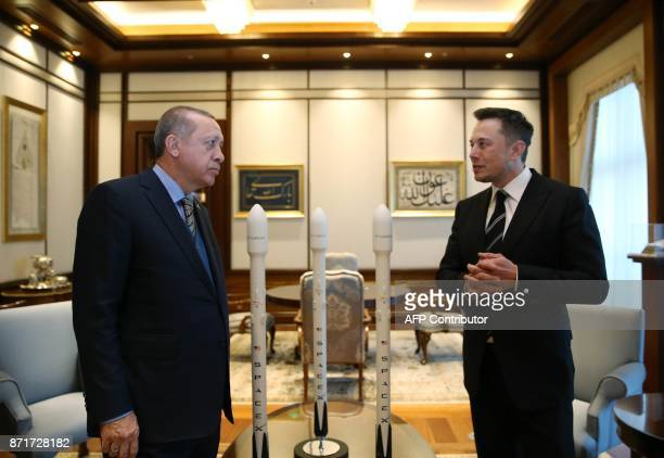 Turkish President Recep Tayyip Erdogan speaks with the founder of US aerospace manufacturer and space transport services company SpaceX Elon Musk...