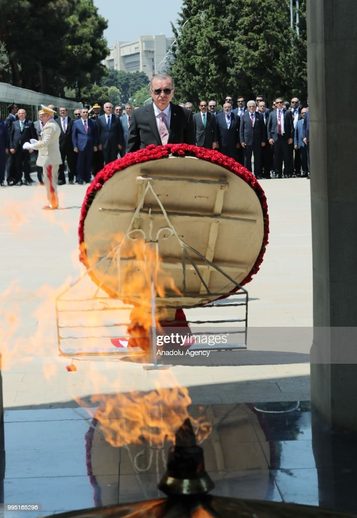 Turkish President Recep Tayyip Erdogan stands next to a Turkish flag wreath at the Turkish and Azerbaijani Martyrdoms within his official visit in Baku, Azerbaijan on July 10, 2018.