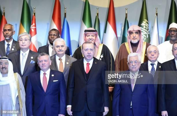 Turkish President Recep Tayyip Erdogan stands next to Emir of Kuwait Sabah AlAhmad AlJaber AlSabah Jordan's King Abdullah and Palestinian President...