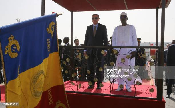 N'DJAMENA CHAD DECEMBER 26 Turkish President Recep Tayyip Erdogan stands next to President of Chad Idriss Deby during a welcoming ceremony upon his...