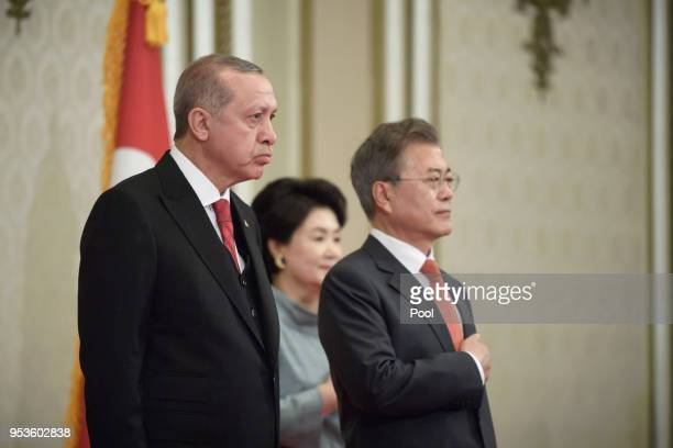 Turkish President Recep Tayyip Erdogan stands with South Korean President Moon Jae-in during a welcoming ceremony at the Presidential Blue House in...