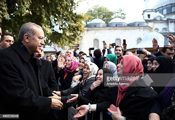 Turkish President Recep Tayyip Erdogan talks with citizens after performing dawn prayer at Eyup Sultan Mosque in Istanbul Turkey on November 02 2015