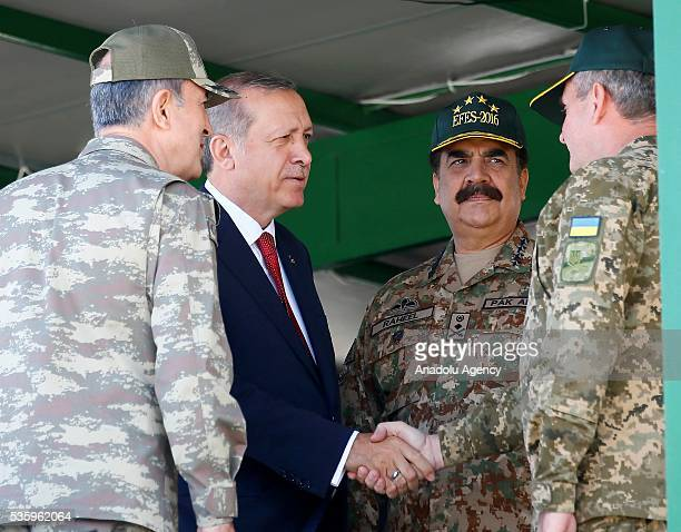 Turkish President Recep Tayyip Erdogan talks with participants during the Efes2016 Combined Joint Live Fire Exercise at Seferihisar district of Izmir...