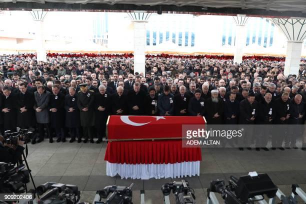 TOPSHOT Turkish President Recep Tayyip Erdogan the Speaker of the Grand National Assembly of Turkey Ismail Kahraman Turkish Prime Minister Binali...