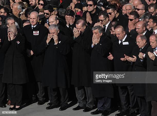 Turkish President Recep Tayyip Erdogan Turkish Prime Minister Binali Yildirim and others pray for police officers killed in yesterday's blast on...