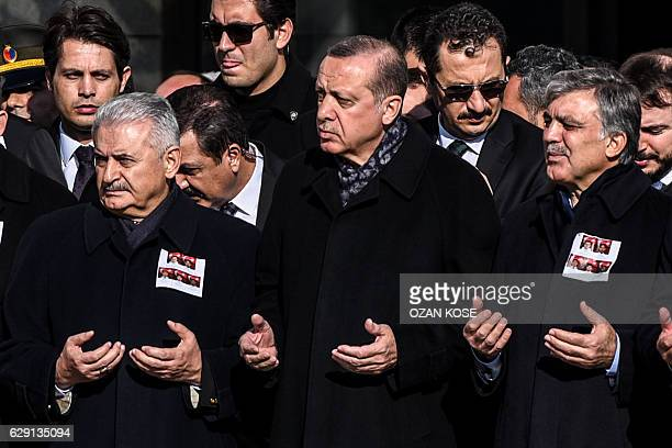 Turkish President Recep Tayyip Erdogan Turkish Prime Minister Binali Yildirim and former Turkish president Abdullah Gul pray as they attend a funeral...