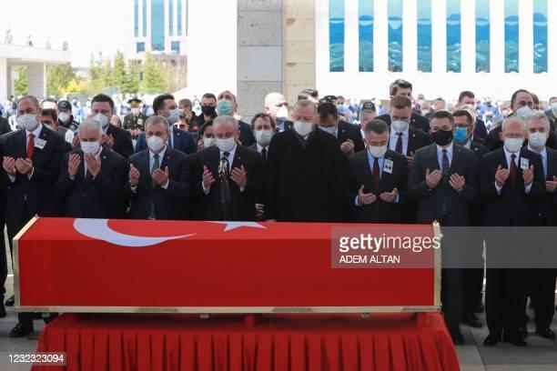 Turkish President Recep Tayyip Erdogan Turkish Vice President Fuat Oktay , and deputy chairman of the AK Party Binali Yildirim pray during the...