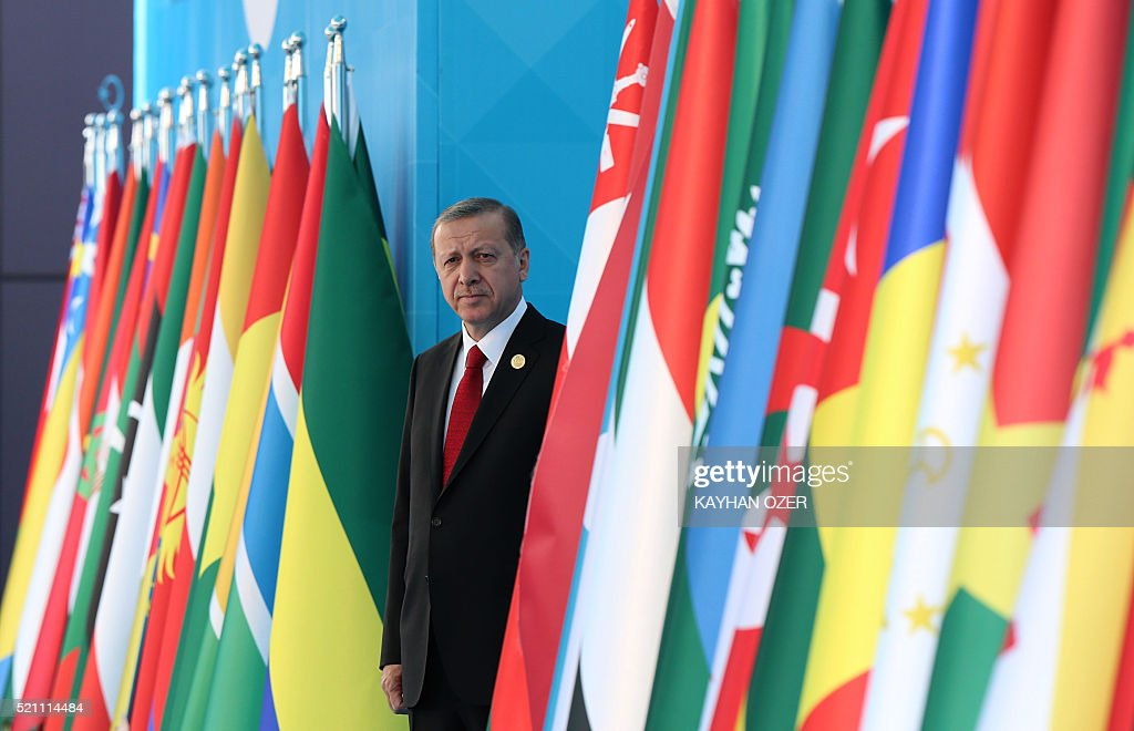 Turkish President Recep Tayyip Erdogan waits during a welcoming ceremony of the 13th Organization of Islamic Cooperation (OIC) Summit at Istanbul Congress Center (ICC) on April 14,2016 in Istanbul. Turkish President Recep Tayyip Erdogan on Thursday hosts over 30 heads of state and government from Islamic countries in Istanbul for a major summit aimed at overcoming differences in the Muslim world. Turkey seeks to showcase its influence in the Muslim world, particularly in lands once controlled by the Ottoman Empire, at the two-day summit of the Organisation of Islamic Cooperation (OIC). / AFP / POOL / KAYHAN