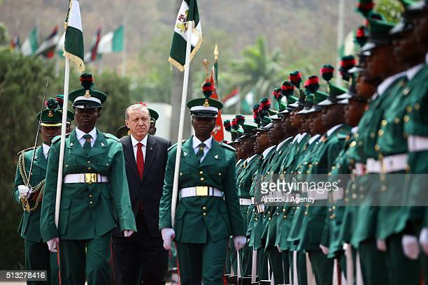 Turkish President Recep Tayyip Erdogan walks past the honor guards during an official welcoming ceremony prior to a meeting with Nigerian President...