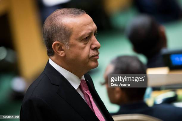 Turkish President Recep Tayyip Erdogan walks to his seat before US President Donald Trump addresses the United Nations General Assembly at UN...