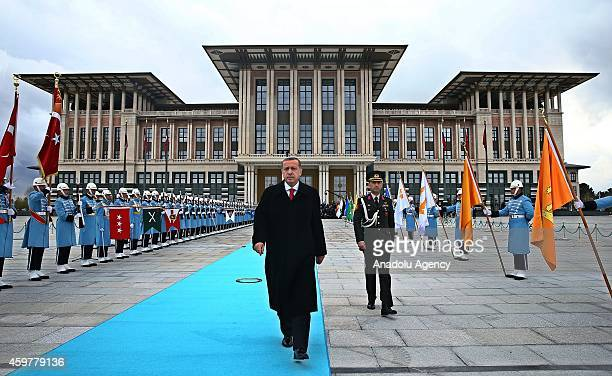 Turkish President Recep Tayyip Erdogan walks to welcome Russian President Vladimir Putin during the official welcoming ceremony at Turkey's...