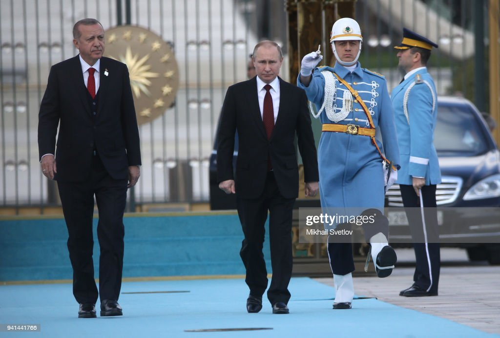 Turkish President Recep Tayyip Erdogan walks with Russian President Vladimir Putin during a welcome ceremony at the presidential palace on April 3, 2018 in Ankara, Turkey. Russian President Vladimir Putin is having a two-days state visit to Turkey.