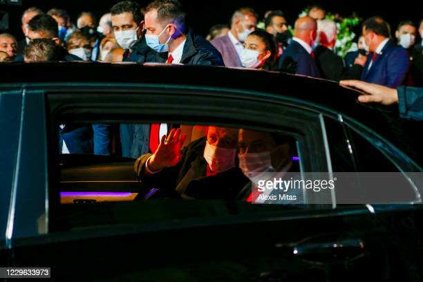Turkish President Recep Tayyip Erdogan waves as he leaves after a visit with the newly elected Turkish Cypriot leader Ersin Tatar on November 15,...