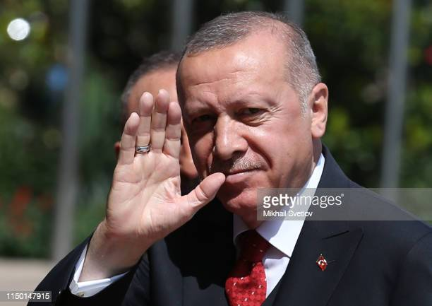 Turkish President Recep Tayyip Erdogan waves during the 5th Summit of the Conference on Interaction and Confidencebuilding measures in Asia in...