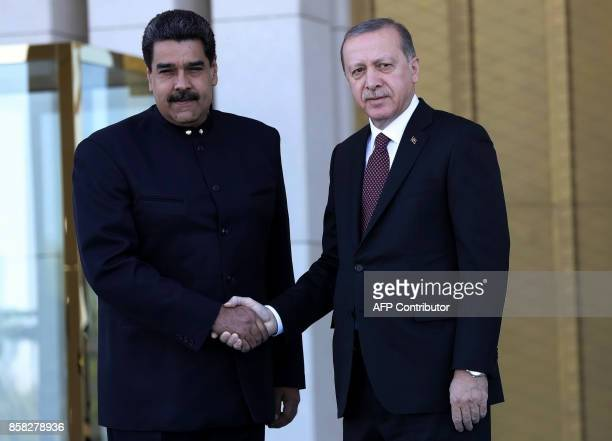 Turkish President Recep Tayyip Erdogan welcomes Venezuelan President Nicolas Maduro at the Presidential Complex in Ankara on October 6 2017 / AFP...
