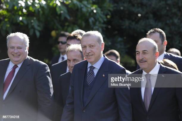 Turkish President Recep Tayyip Erdogan with Foreign Minister Mevlut Cavusoglu arrive for his meeting with Greek Prime Minister on December 7 2017 in...
