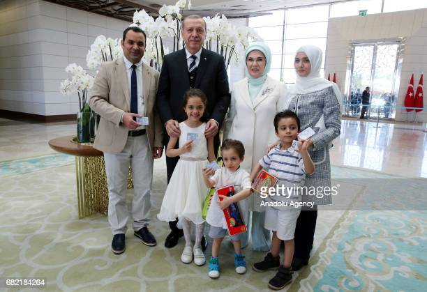 Turkish President Recep Tayyip Erdogan with his wife Emine Erdogan gives Turkish identity cards to sevenyearold Syrian girl Bana AlAbed and her...