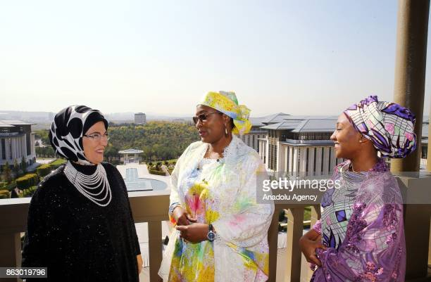 Turkish President Recep Tayyip Erdogan's spouse Emine Erdogan and Nigerian President Muhammadu Buhari's spouse Aisha Buhari talk together at the...