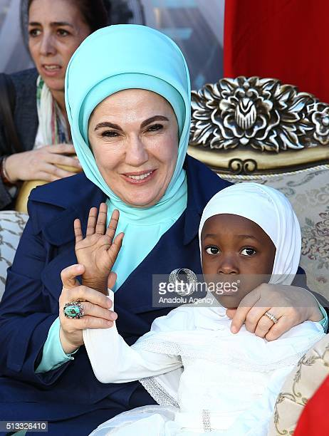 Turkish President Recep Tayyip Erdogan's wife Emine Erdogan and Nigerian President Muhammadu Buhari's wife Aisha Buhari take cares with orphan...