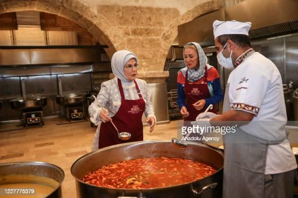 Turkish President Recep Tayyip Erdogan's wife Emine Erdogan distributes food to needy people at Istanbul's oldest soup kitchen Eyup Imaret's dining...