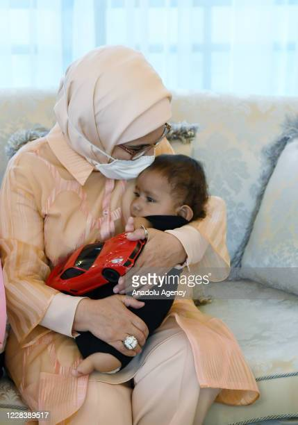 Turkish President Recep Tayyip Erdogan's wife Emine Erdogan holds the congenital amputee Syrian child Mohammad Mosaitef as she host his family in...