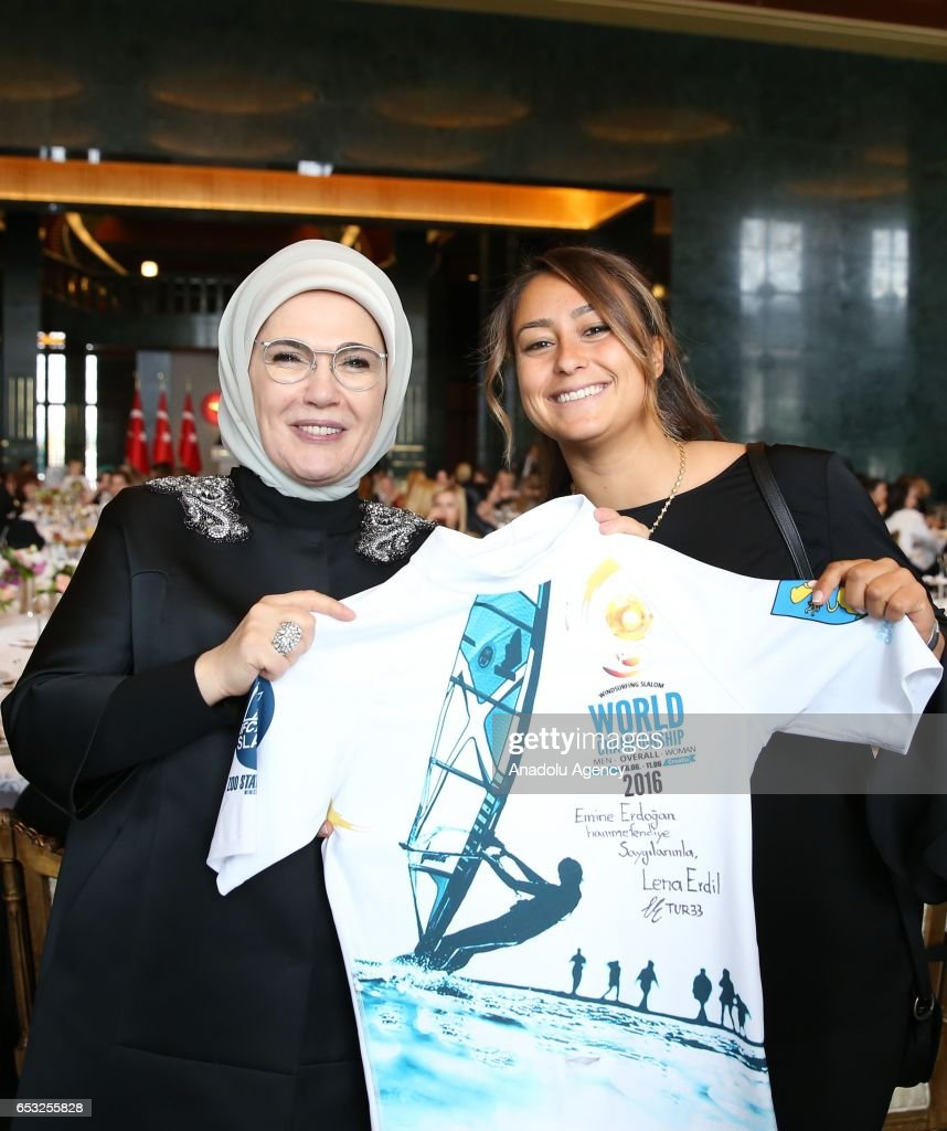 Turkish President Recep Tayyip Erdogan's wife Emine Erdogan (L) poses for a photo with Turkish professional windsurfer Lena Erdil (R) as she attends a dinner gathering business women, female athletes and artists at the Presidential Complex in Ankara, Turkey on March 14, 2017.