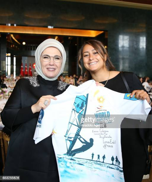 Turkish President Recep Tayyip Erdogan's wife Emine Erdogan poses for a photo with Turkish professional windsurfer Lena Erdil as she attends a dinner...