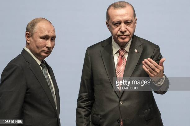 Turkish President Tayyip Erdogan and his Russian counterpart Vladimir Putin attend a ceremony marking the completion of the sea part of the...