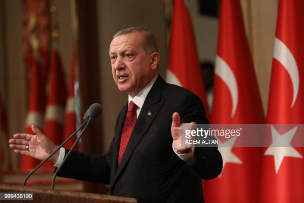 Turkish President Tayyip Erdogan delivers a speech during a ceremony marking the second anniversary of the attempted coup at the Presidential Palace...