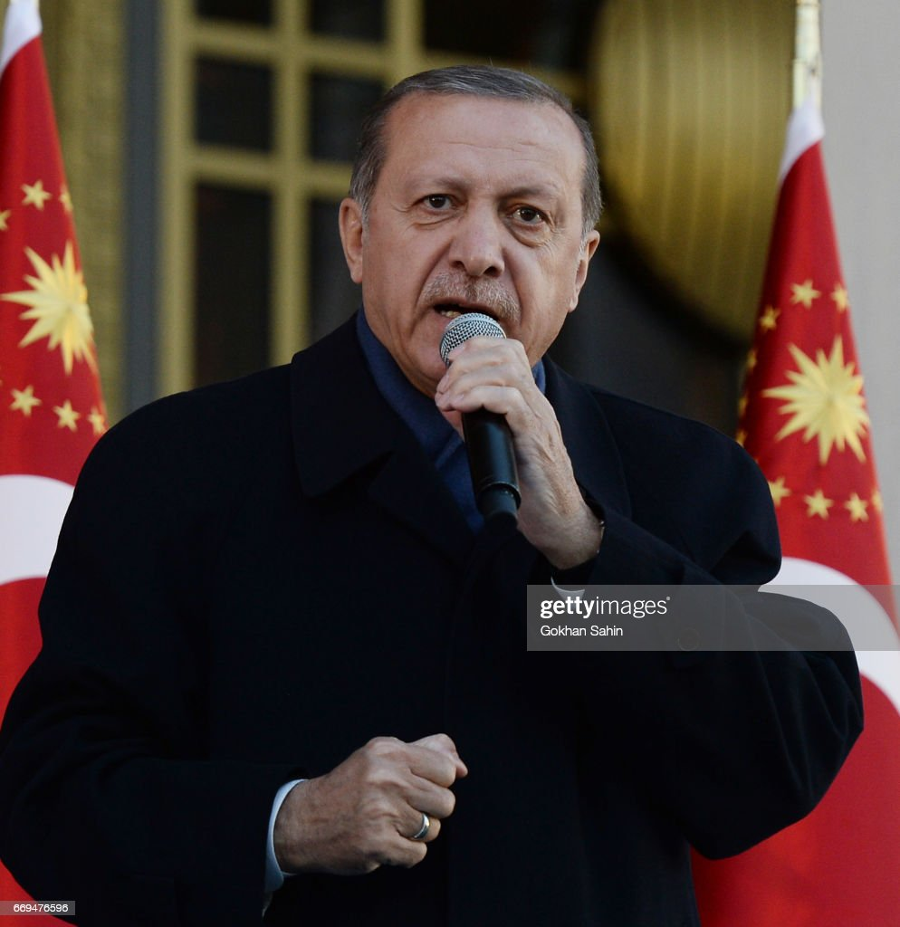 Turkish President Tayyip Erdogan gives a referendum victory speech to his supporters at the Presidential Palace on April 17, 2017 in Ankara Turkey. Erdogan declared victory in Sunday's historic referendum that will grant sweeping powers to the presidency, hailing the result as a 'historic decision. 51.4 per cent per cent of voters had sided with the 'Yes' campaign, ushering in the most radical change to the country's political system in modern times.Turkey's main opposition calls on top election board to annul the referendum. OSCE observers said that a Turkish electoral board decision to allow as valid ballots that did not bear official stamps undermined important safeguards against fraud.