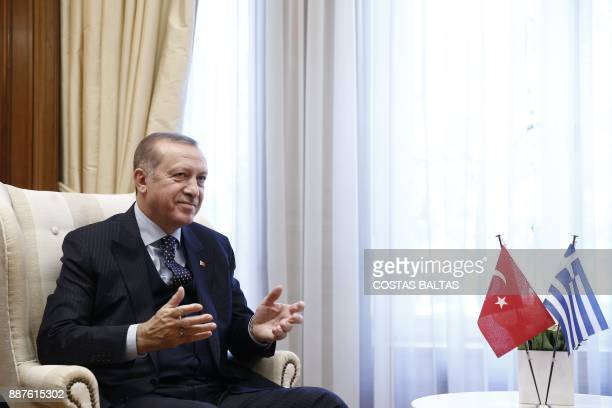 Turkish President Tayyip Erdogan meets with the Greek prime minister at the Maximos Mansion in Athens on December 7 2017 President Recep Tayyip...