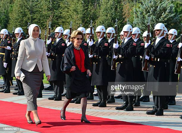 Turkish President's spouse Hayrunnisa Gul and Queen Sonja of Norway walk during the official welcoming ceremony on November 5, 2013 at Cankaya...