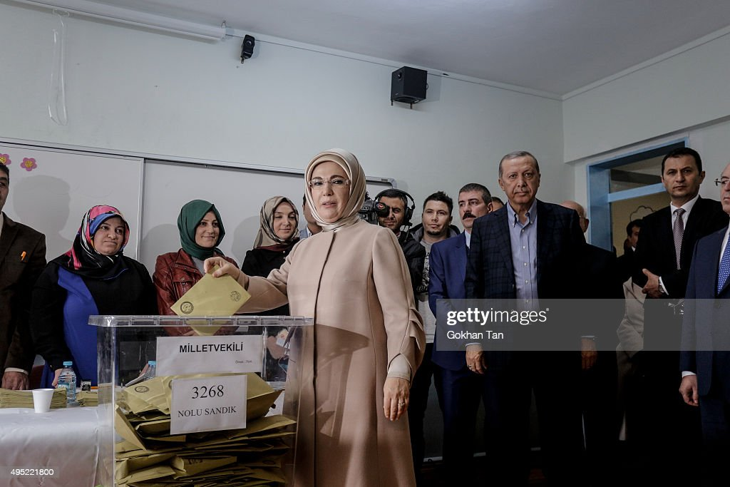 Turkish Presidents Tayyip Erdogan's wife Emine poses as she casts his ballot at a polling stationon November 1, 2015, in Istanbul, Turkey. Polls have opened in Turkey's second general election this year, with the ruling Justice and Development Party (AKP) hoping to win a majority, as the country searches for stability amongst serious security concerns.