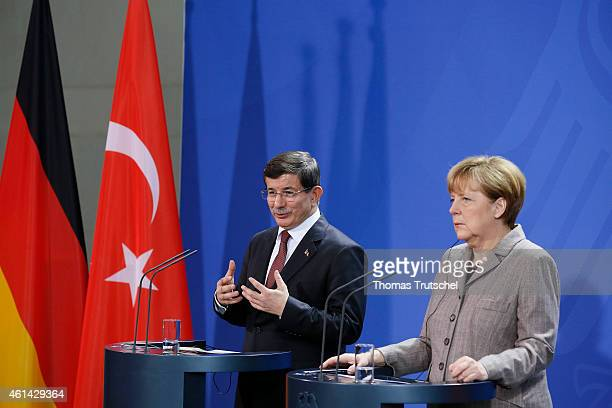 Turkish Prime Minister Ahmet Davutoglu and German Chancellor Angela Merkel speaks to the media after their meeting at the Chancellery on January 12...
