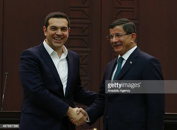 Turkish Prime Minister Ahmet Davutoglu and his Greek counterpart Alexis Tsipras shake hands following a press conference at the Cankaya palace in...