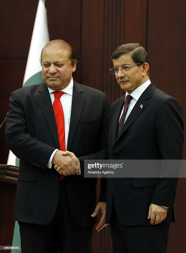 Turkish Prime Minister Ahmet Davutoglu (R) and Pakistani Prime Minister Nawaz Sharif (L) shake hands after their joint press conference at the Prime Ministry office at Cankaya Palace on April 03, 2015 in Ankara, Turkey.