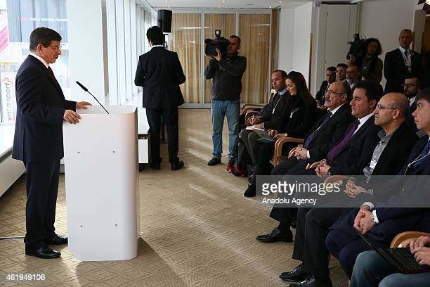 Turkish Prime Minister Ahmet Davutoglu answers journalists' questions during a press conference on the second day of the World Economic Forum at...