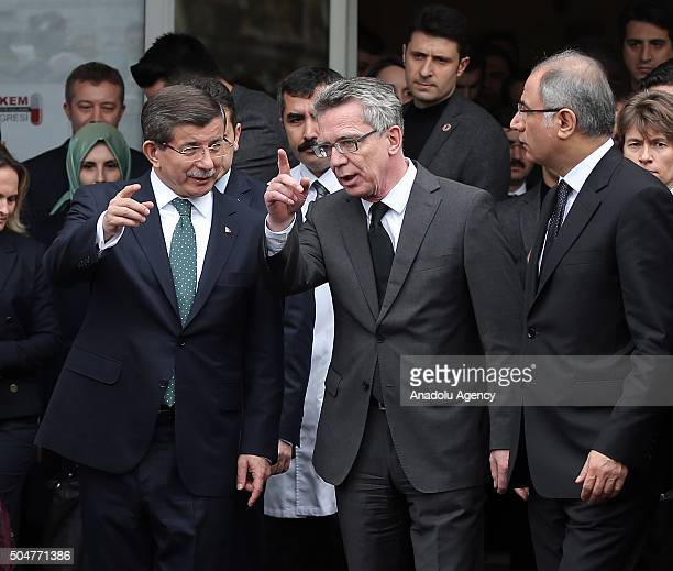 Turkish Prime Minister Ahmet Davutoglu German Interior Minister Thomas de Maiziere and Turkish Interior Minister Efkan Ala leave after a visit to the...