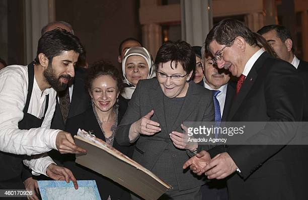 Turkish Prime Minister Ahmet Davutoglu gives a paper marbling on which there are Turkish and Polish flags, made by the marbling artist Garip Ay...