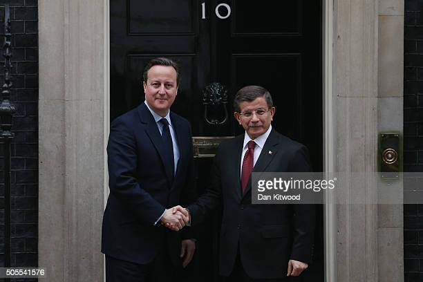 Turkish Prime Minister Ahmet Davutoglu is greeted by British Prime Minister David Cameron at 10 Downing Street on January 18 2016 in London England...