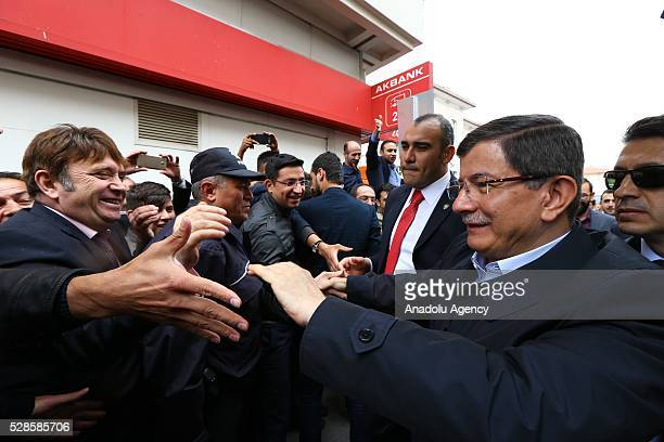 Turkish Prime Minister Ahmet Davutoglu meets his supporters as he decided not to stand in fresh leadership election in the extraordinary congress on...