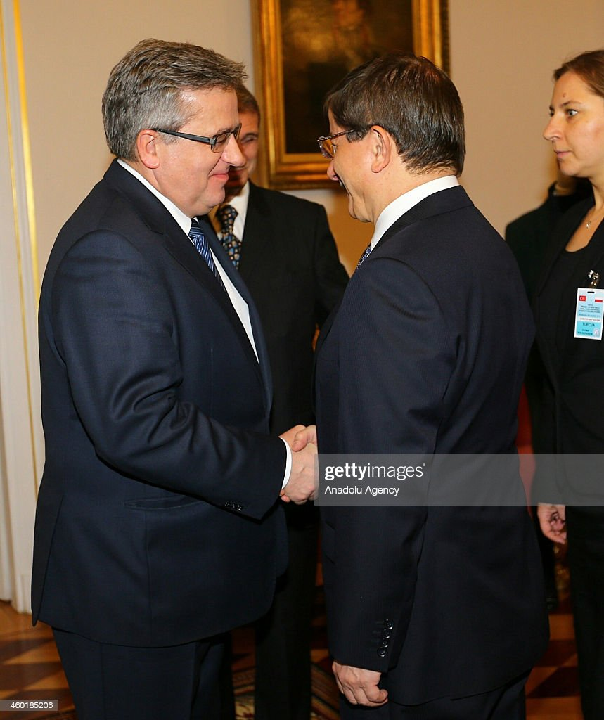 Turkish Prime Minister Ahmet Davutoglu (R) meets President of the Republic of Poland, Bronislaw Komorowski (L) in the capital Warsaw, Poland on December 9,2014. Davutoglu's two-day official visit to Poland focuses on Turkey's EU accession talks, crises in Eastern Ukraine, Iraq and Syria.