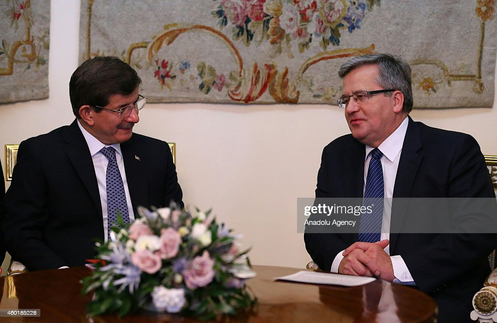 Turkish Prime Minister Ahmet Davutoglu (L) meets President of the Republic of Poland, Bronislaw Komorowski (R) in the capital Warsaw, Poland on December 9,2014. Davutoglu's two-day official visit to Poland focuses on Turkey's EU accession talks, crises in Eastern Ukraine, Iraq and Syria.