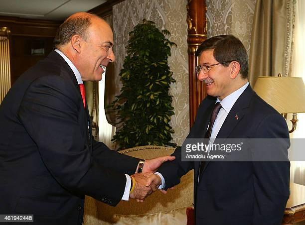 Turkish Prime Minister Ahmet Davutoglu meets with Chairman of the Board and CEO of The CocaCola Company Muhtar Kent during the World Economic Forum...