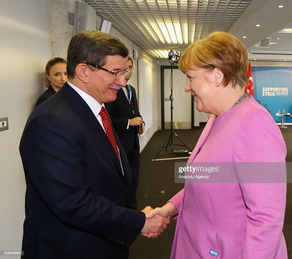 Turkish PM Davutoglu meets German Chancellor Angela Merkel in London : News Photo