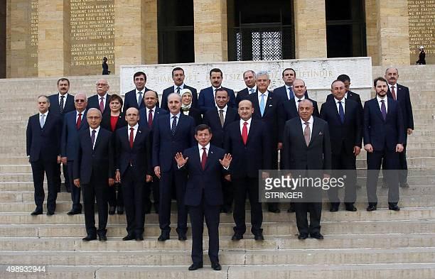 Turkish Prime Minister Ahmet Davutoglu poses with the members of the new Turkish cabinet Deputy Prime Ministers Lutfi Elvan, Mehmet Simsek, Numan...