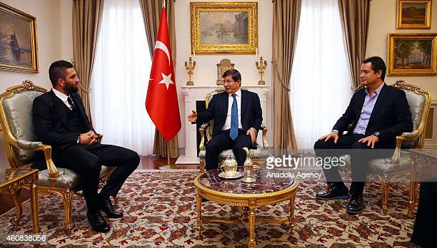 Turkish Prime Minister Ahmet Davutoglu receives Turkish footballer Arda Turan playing for Spanish outfit Atletico de Madrid and the founder and head...